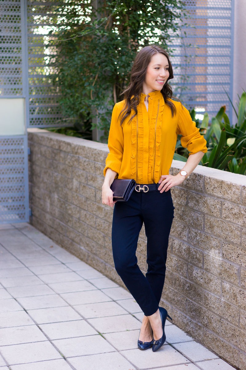 How to Wear Navy & Mustard Yellow together | Work outfit inspiration | Lush tunic blouse | Ann Taylor yellow ruffle blouse | Petite fashion and style blog | Banana Republic Sloan Pants | Gibson burgundy cardigan | Talbots reversible belt | Tory Burch wallet clutch | Office style | yellow and navy