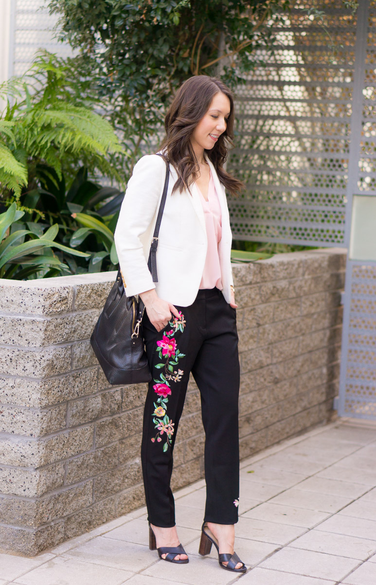Two work outfits for early spring | Lavender pants | Blush pink high-waisted pants | Floral embroidered columnist black pants | Express petite fashion review | Petite style blog | Lush tunic blouse navy pink | Ann Taylor block sandals | Ivory heels | Springtime Summer outfit inspiration | rose gold bracelets accessories